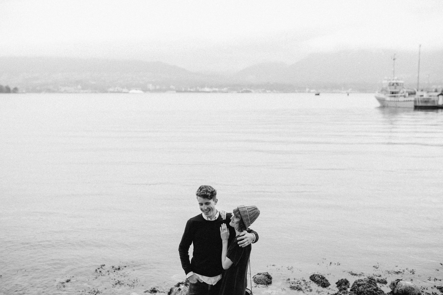 Quirky Couple Laugh on Rocks in VanCity Harbour