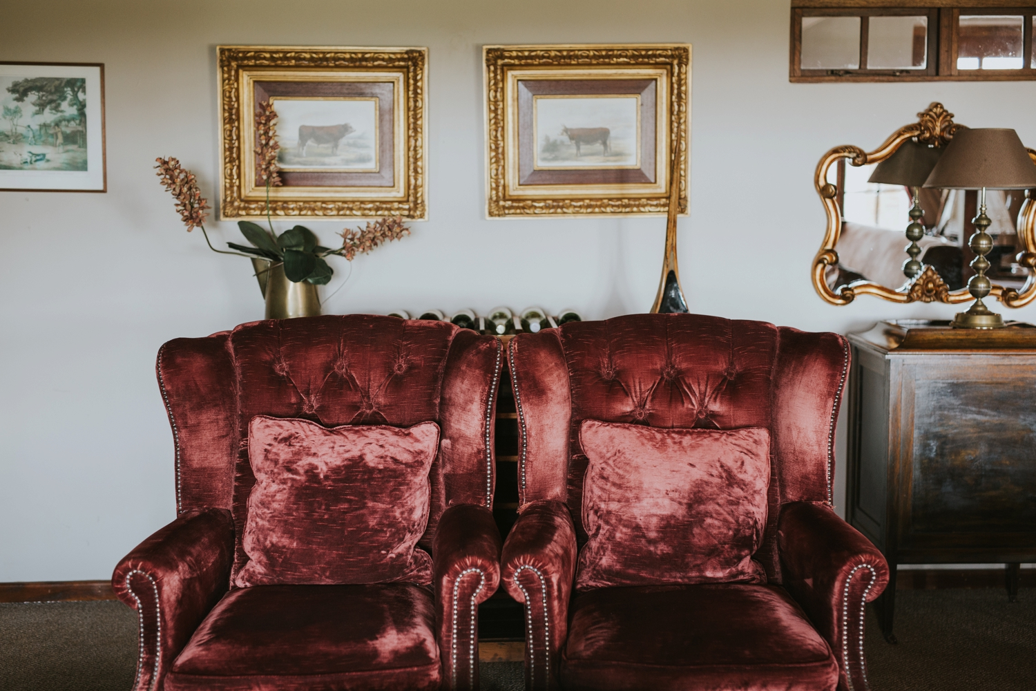 Red velvet couches in Cecil Green Park House