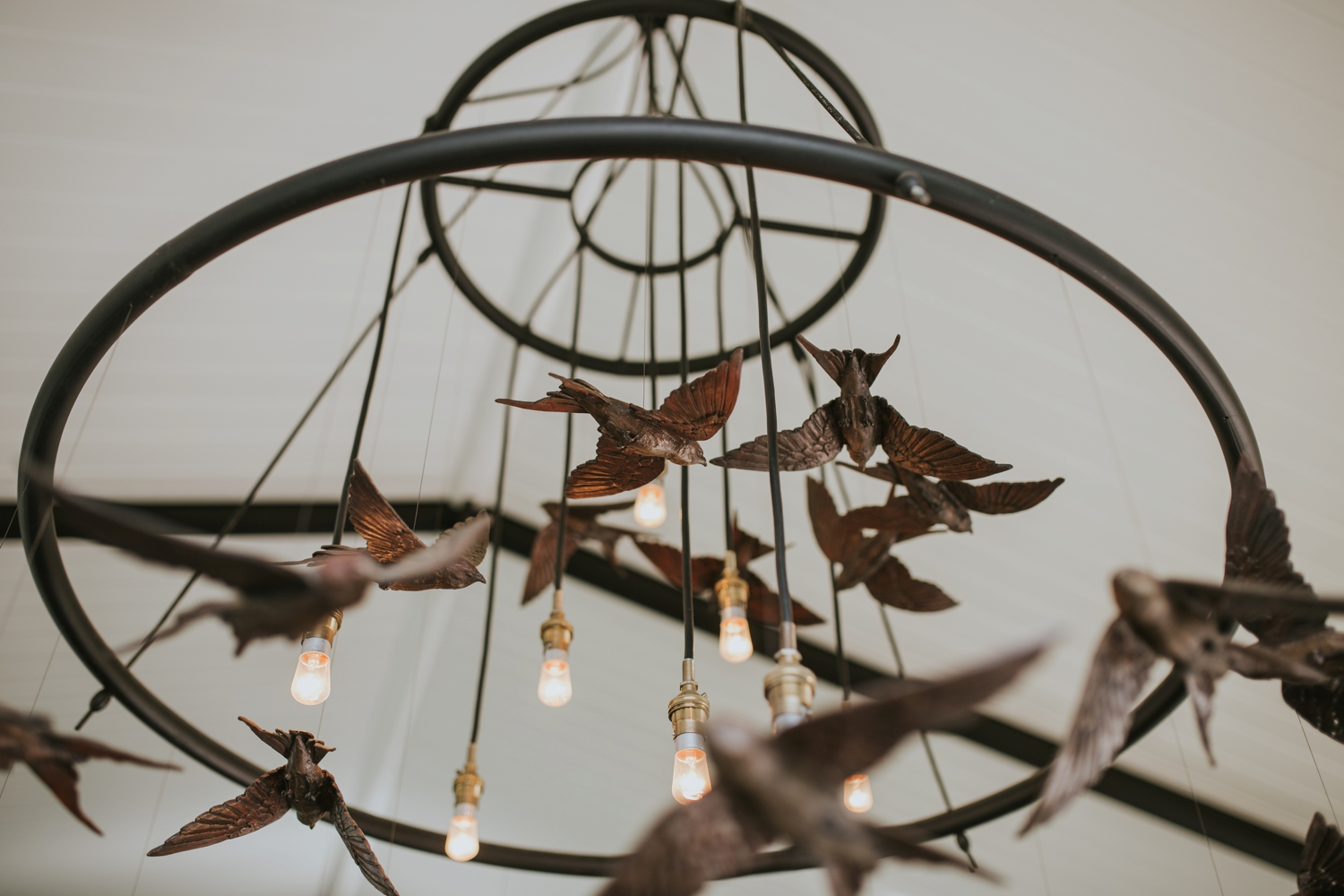 Beautiful handmade bird chandelier at minimalist Vancouver wedding ceremony venue