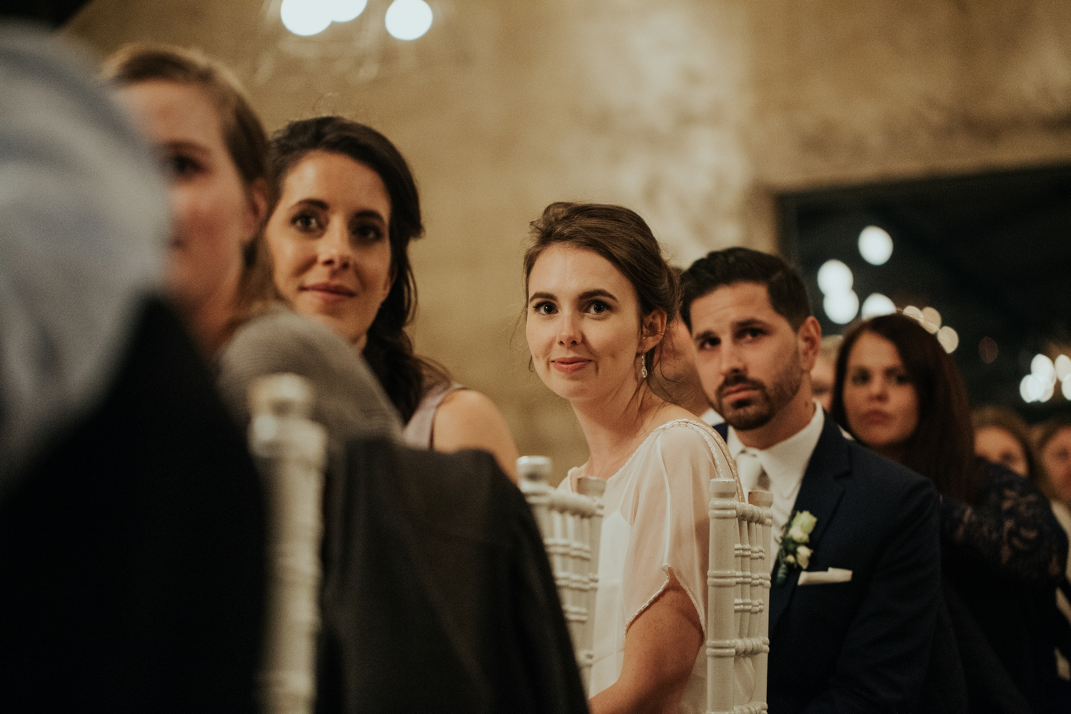 Bride and groom laugh with their guests during speeches at their alternative wedding in Vancouver