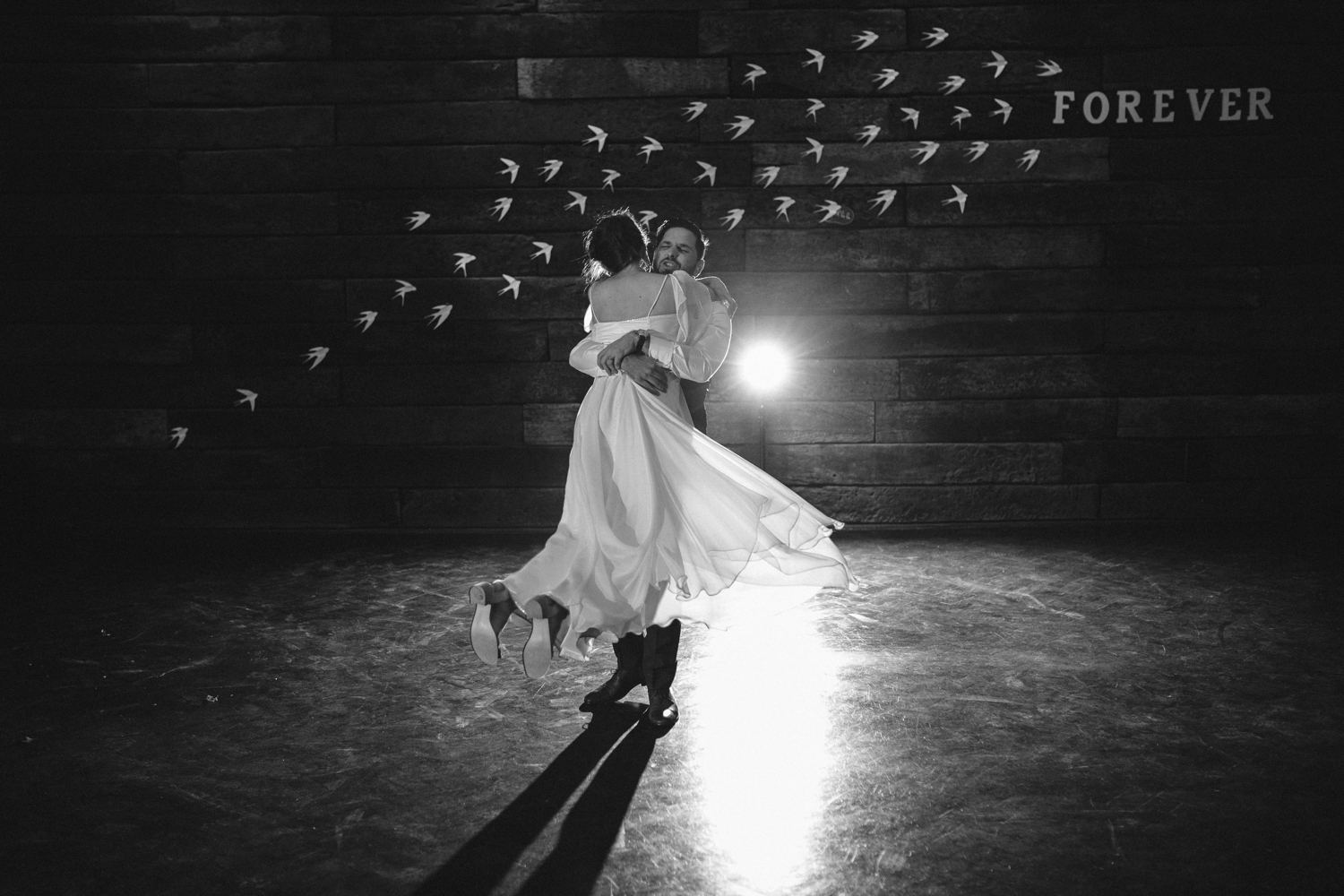 Groom spins bride during their first dance at their Scandi style wedding at the Pipe Shop in North Vancouver