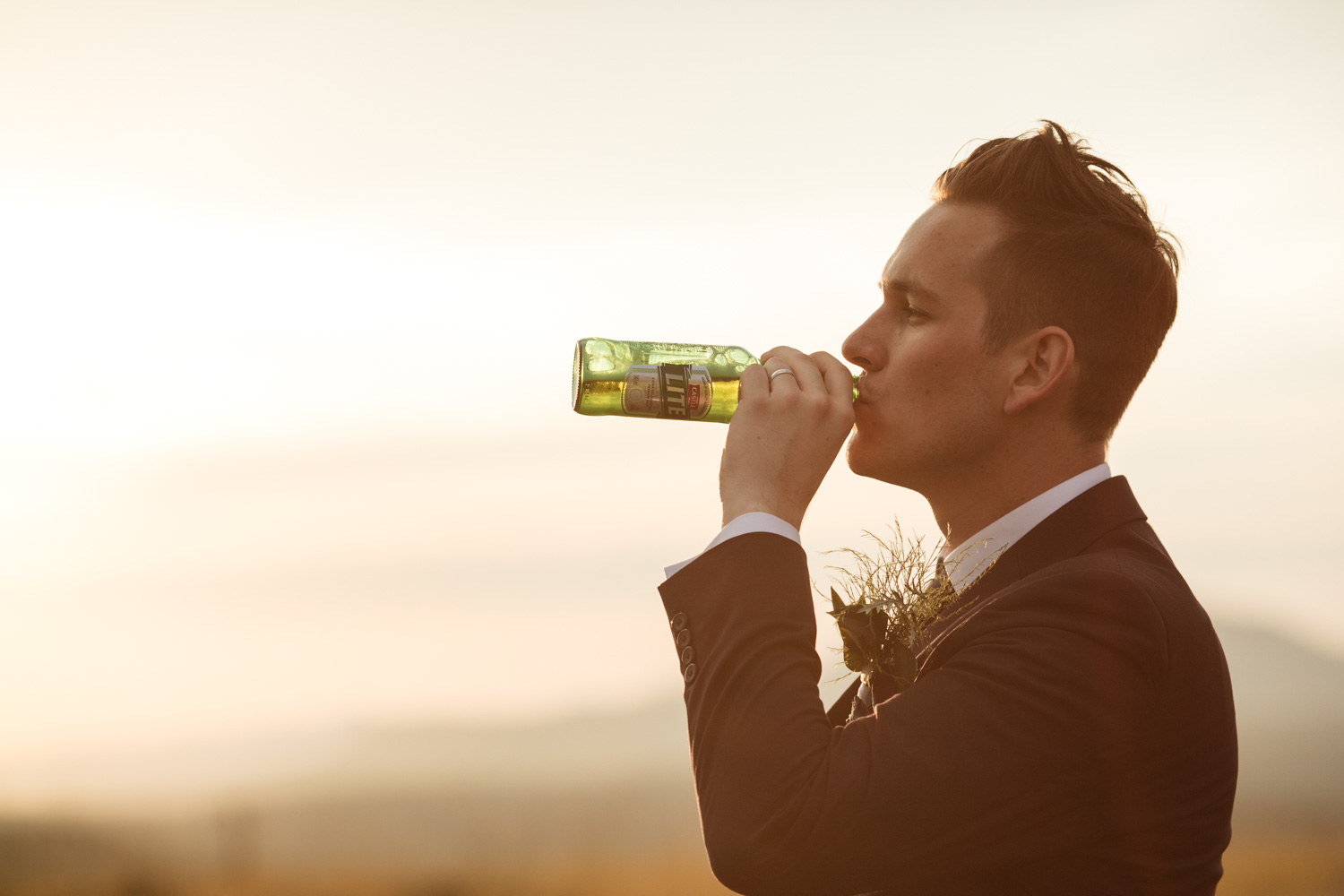 Fun Alternative Groom Portrait Drinking Beer