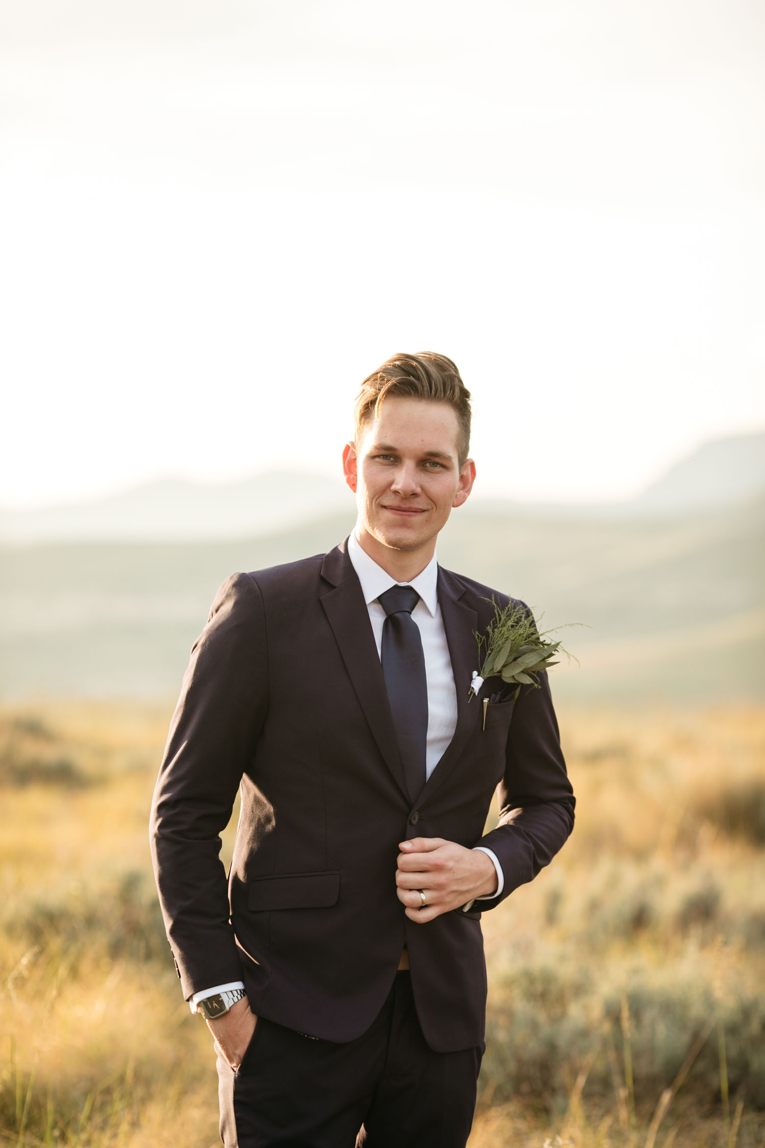Groom In Black Suite Navy Tie Trendy Eucalyptus Lapel