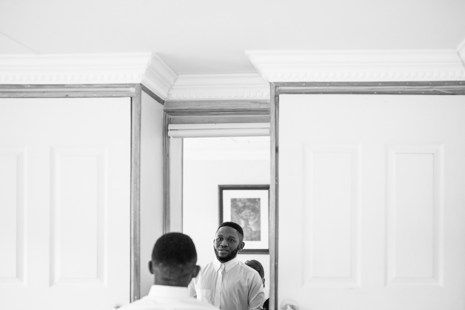 Groomsmen Looks In Mirror Getting Ready Before Wedding Ceremony At St Fort In Clarens