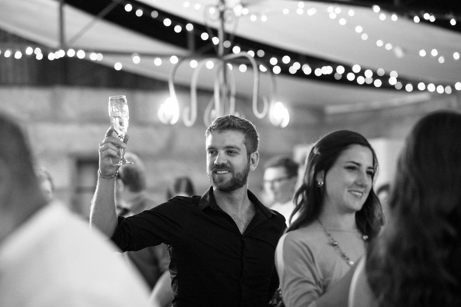 Natural Candid Moment Guest Champagne Toast At Vancouver Wedding Reception Pipe Shop Wedding Venue Shipyards