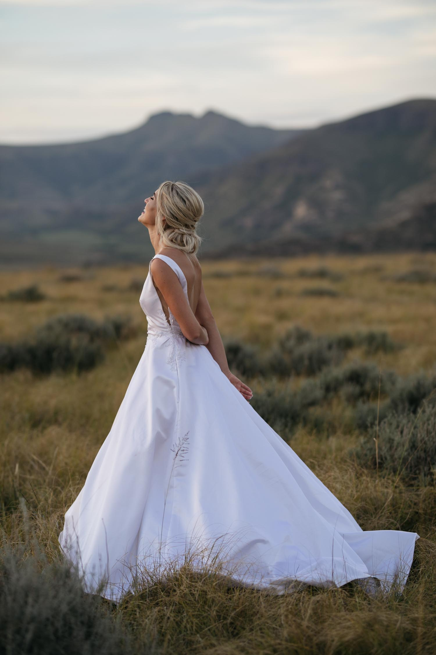 Bridal Portrait Bride Wears Trendy Modern Backless White Wedding Dress