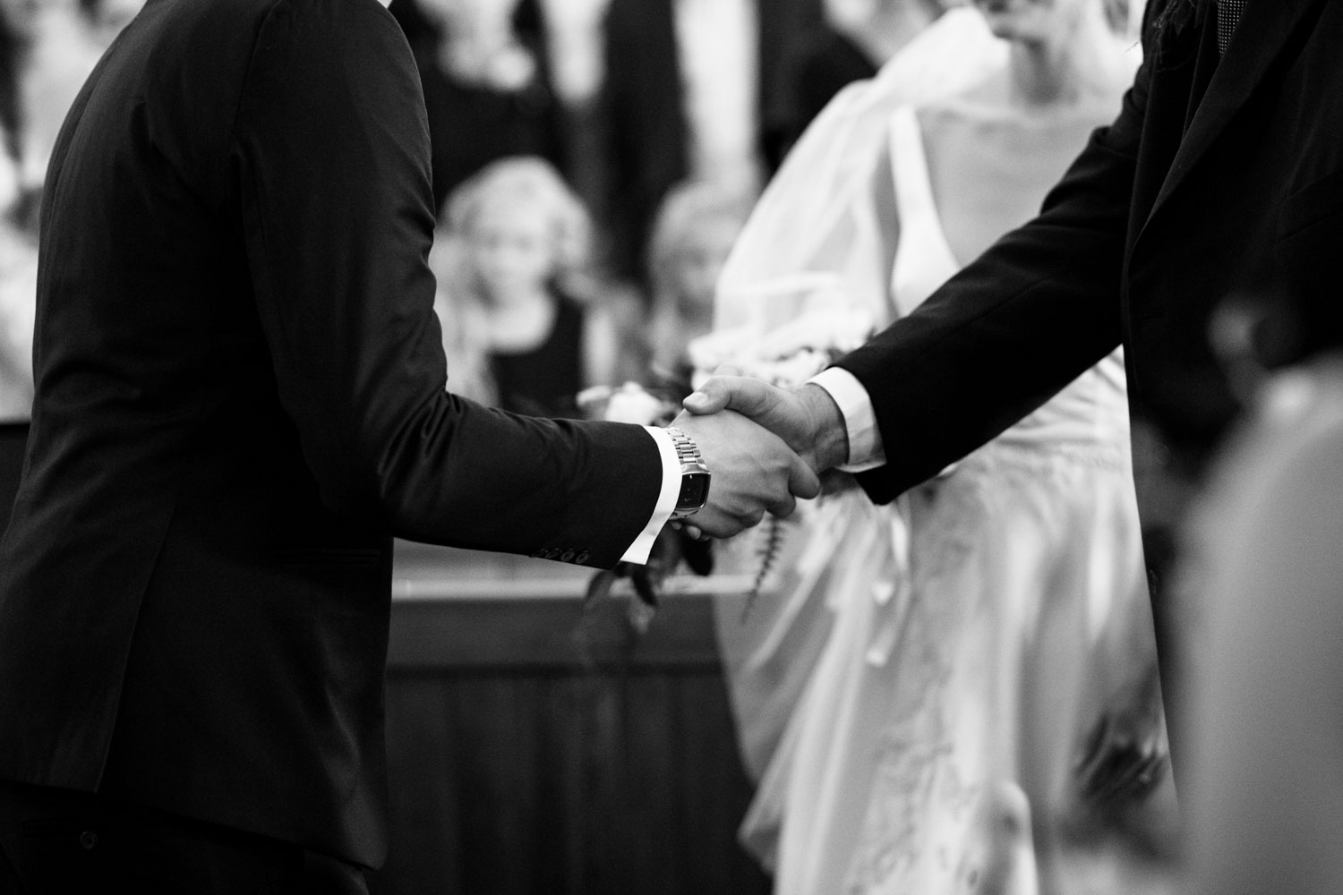 Groom And Bride's Father Shake Hands At End Of Aisle