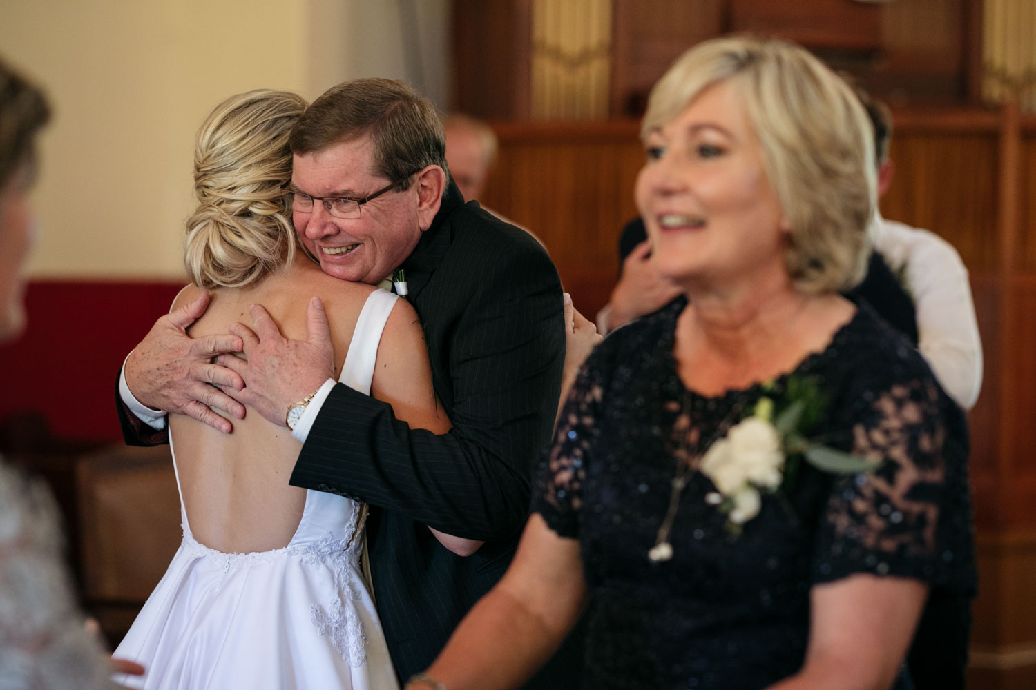 Father Of Bride Hugs And Congratulates Daughter After Wedding Ceremony