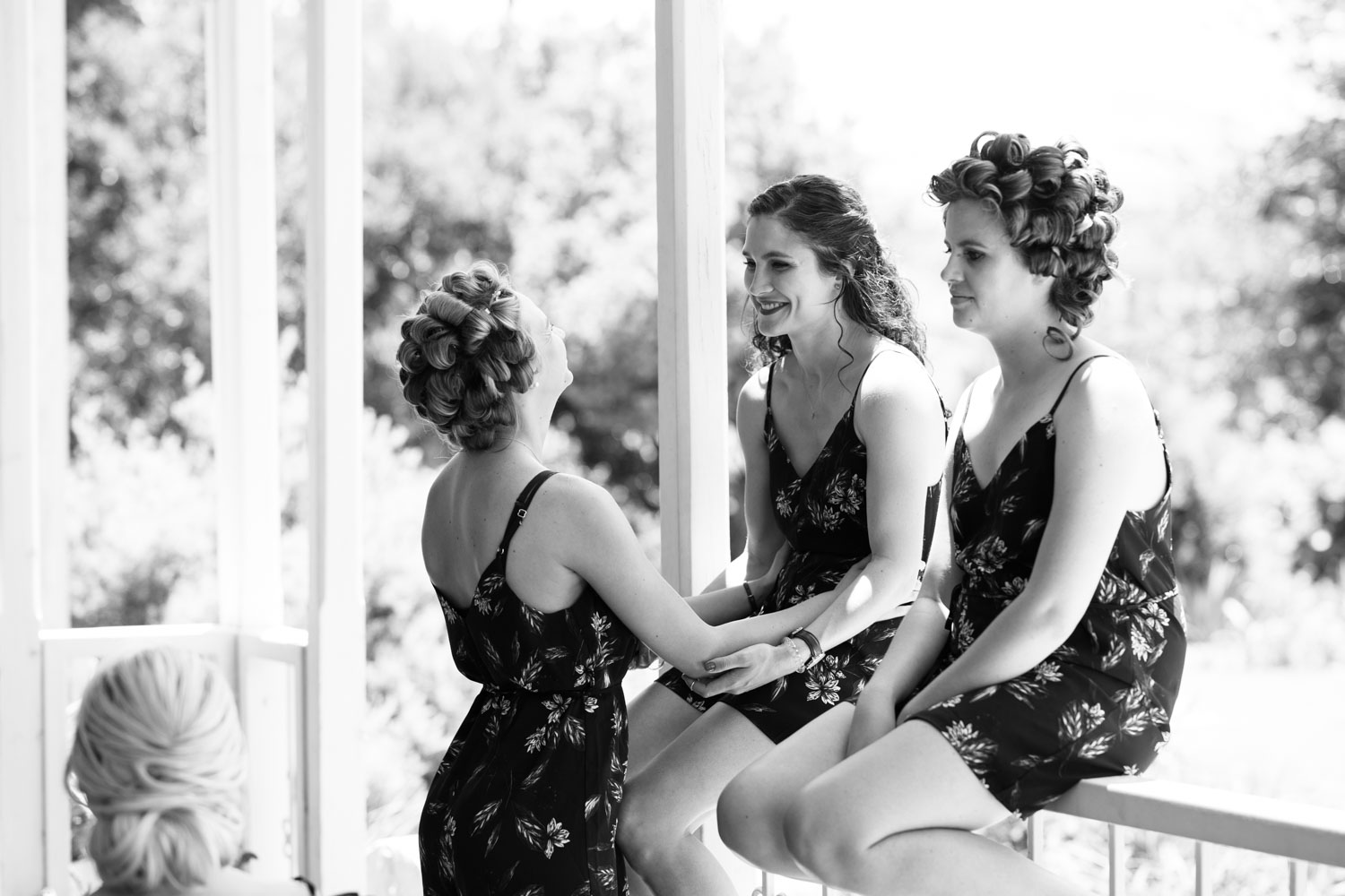 Candid Moment Between Bridesmaids Wearing Cute Playsuits For Getting Ready Photographs