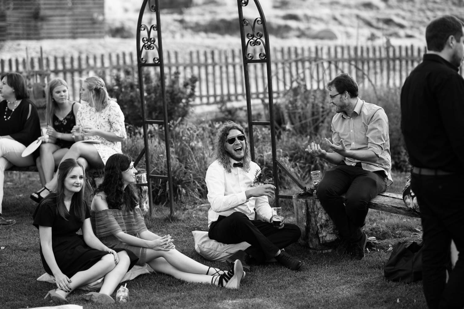 Candid Moments Between Wedding Guests On Lawn During Wedding Cocktail Hour
