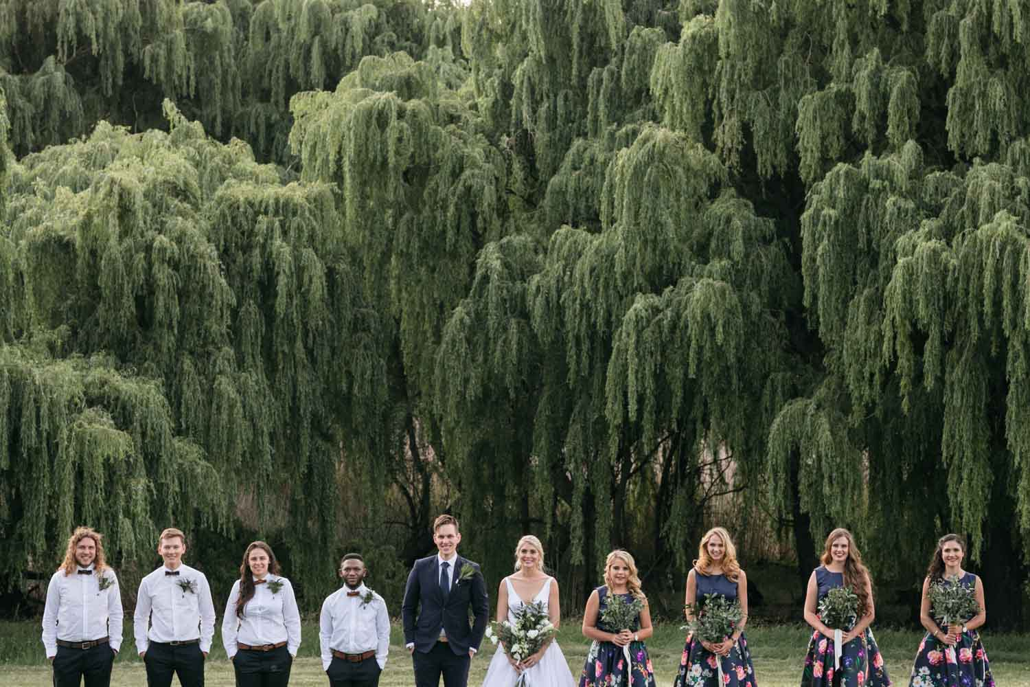 Bridal Party Photo In Front Of Willow Trees In Vancouver
