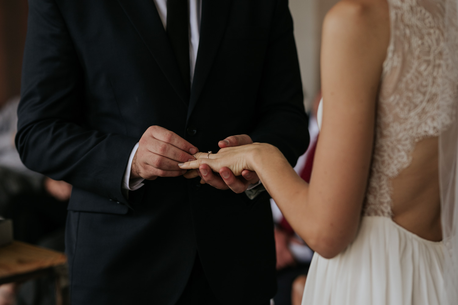 Grooms Puts Wedding Ring On Bride's Finger In Vancouver City Wedding Ceremony