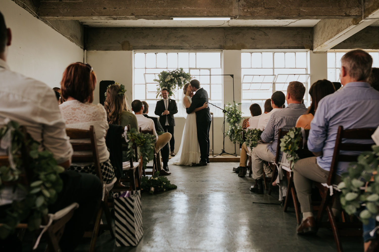 First Kiss In Vancouver Modern City Warehouse Wedding Venue