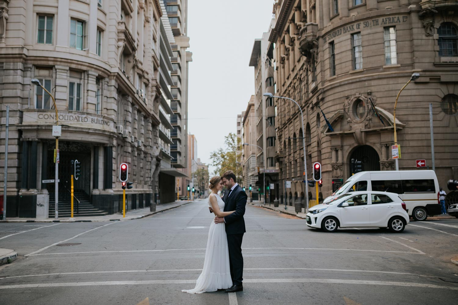 Bride And Groom Hug In Road In Vancouver City Streets