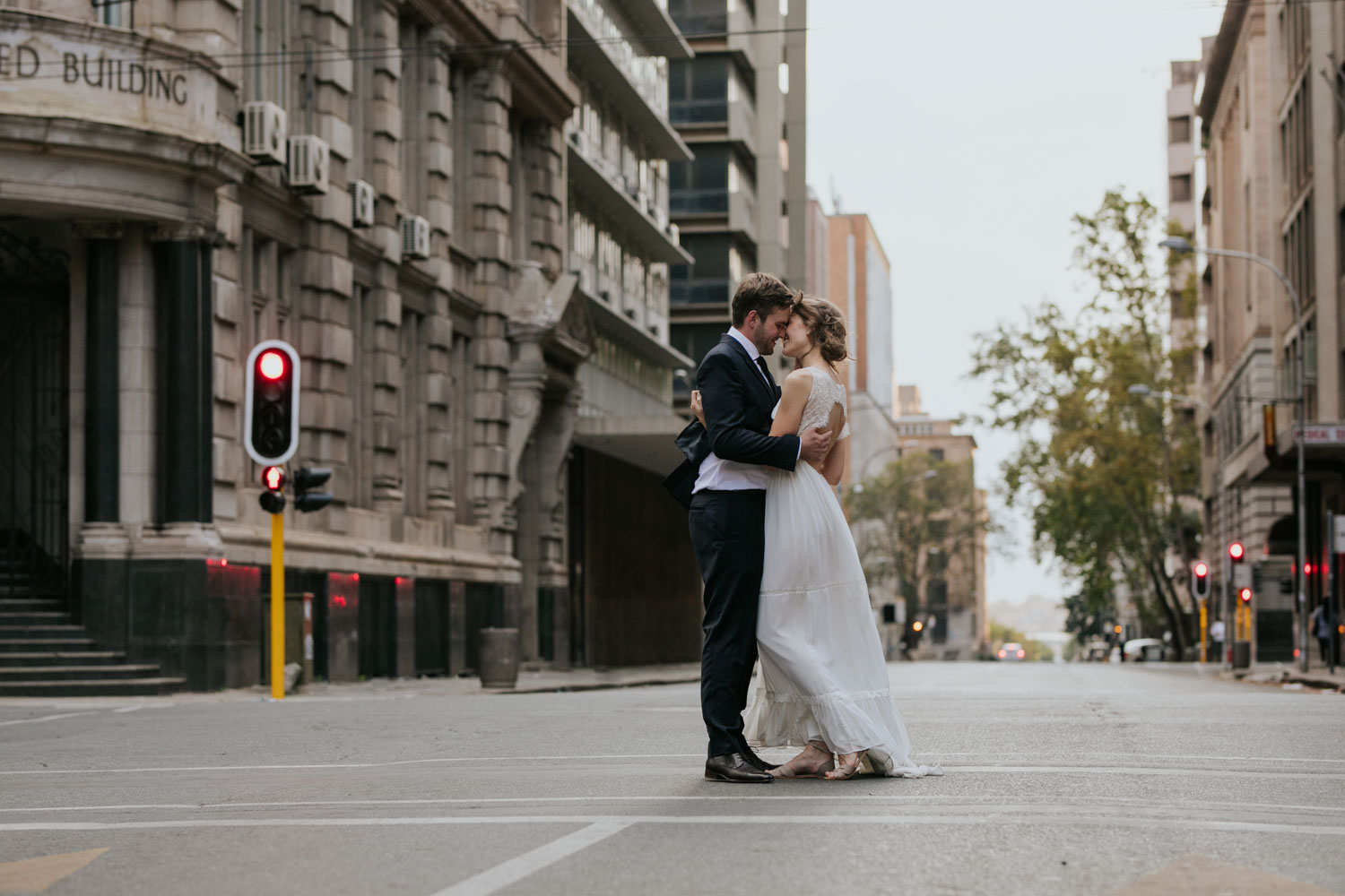 Bride And Groom Dance In Road In Vancouver City Streets