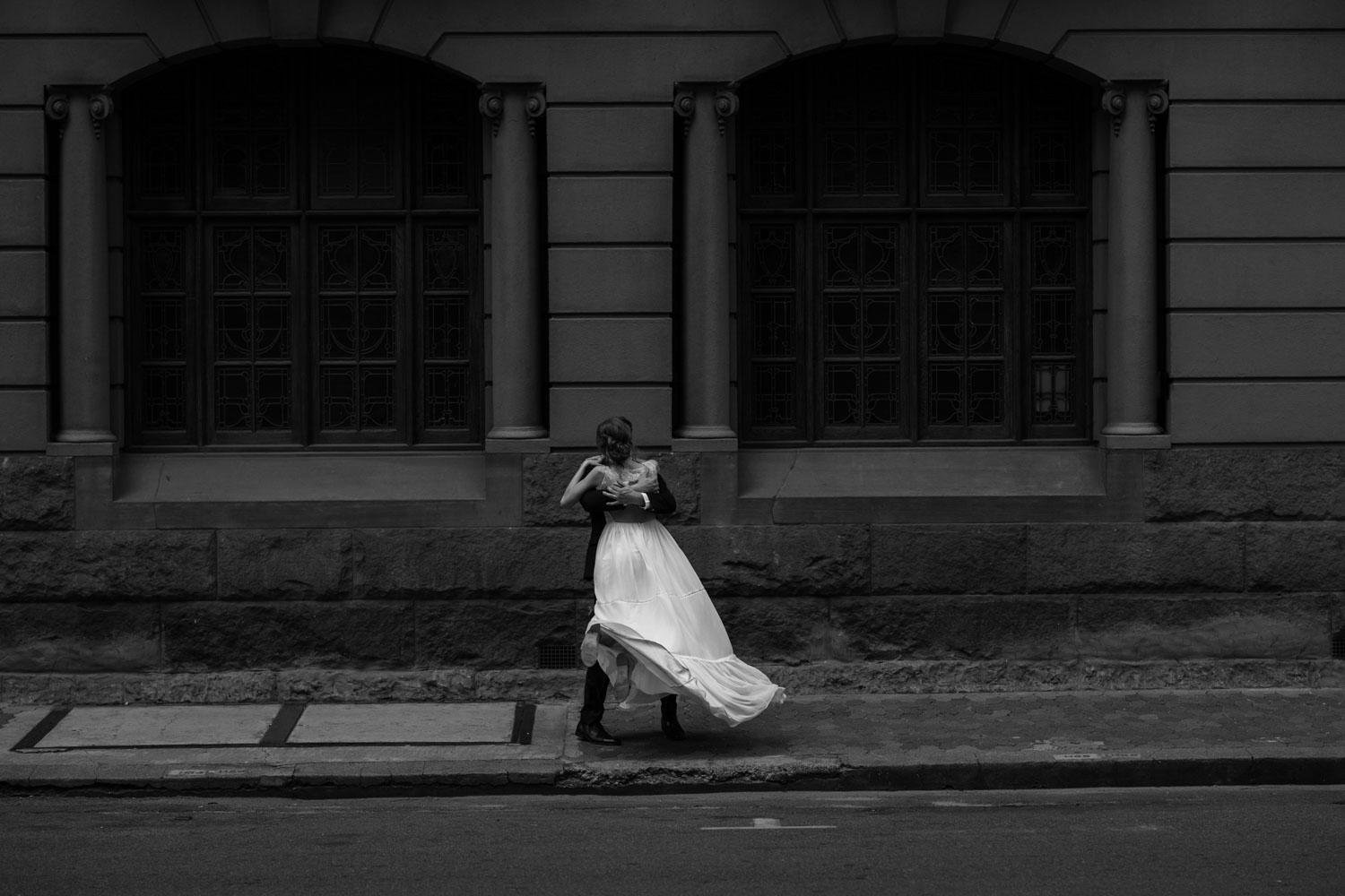 Grooms Spins Bride In Front Of Epic Old Vancouver Heritage Building