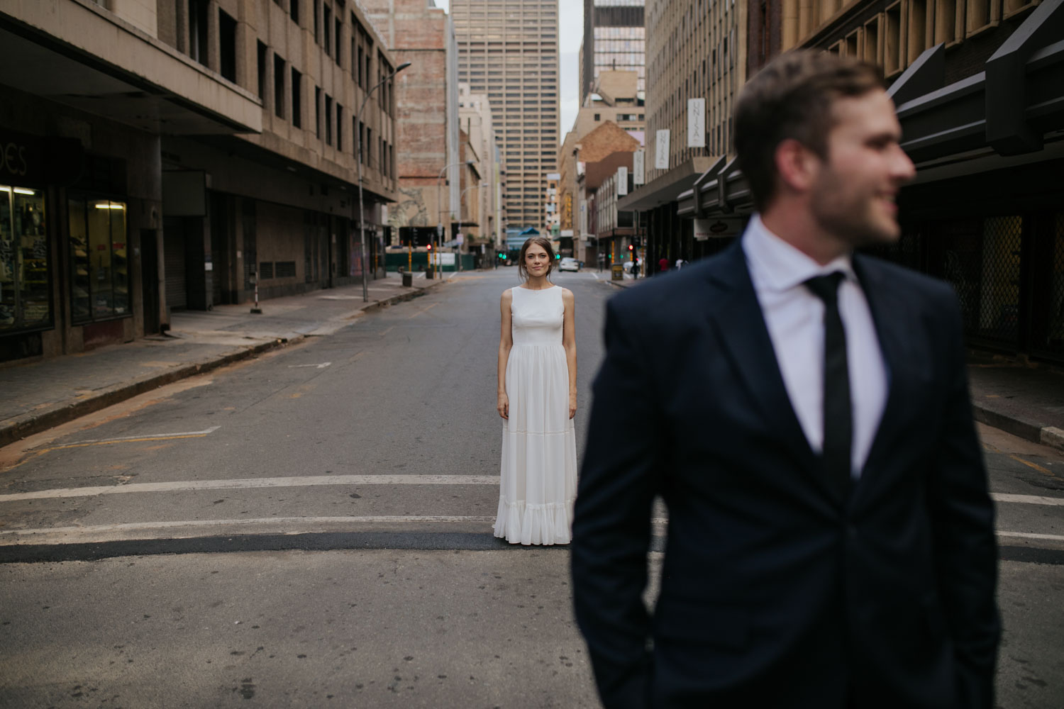 Photo Of Bride In Focus Looking At Her New Husband