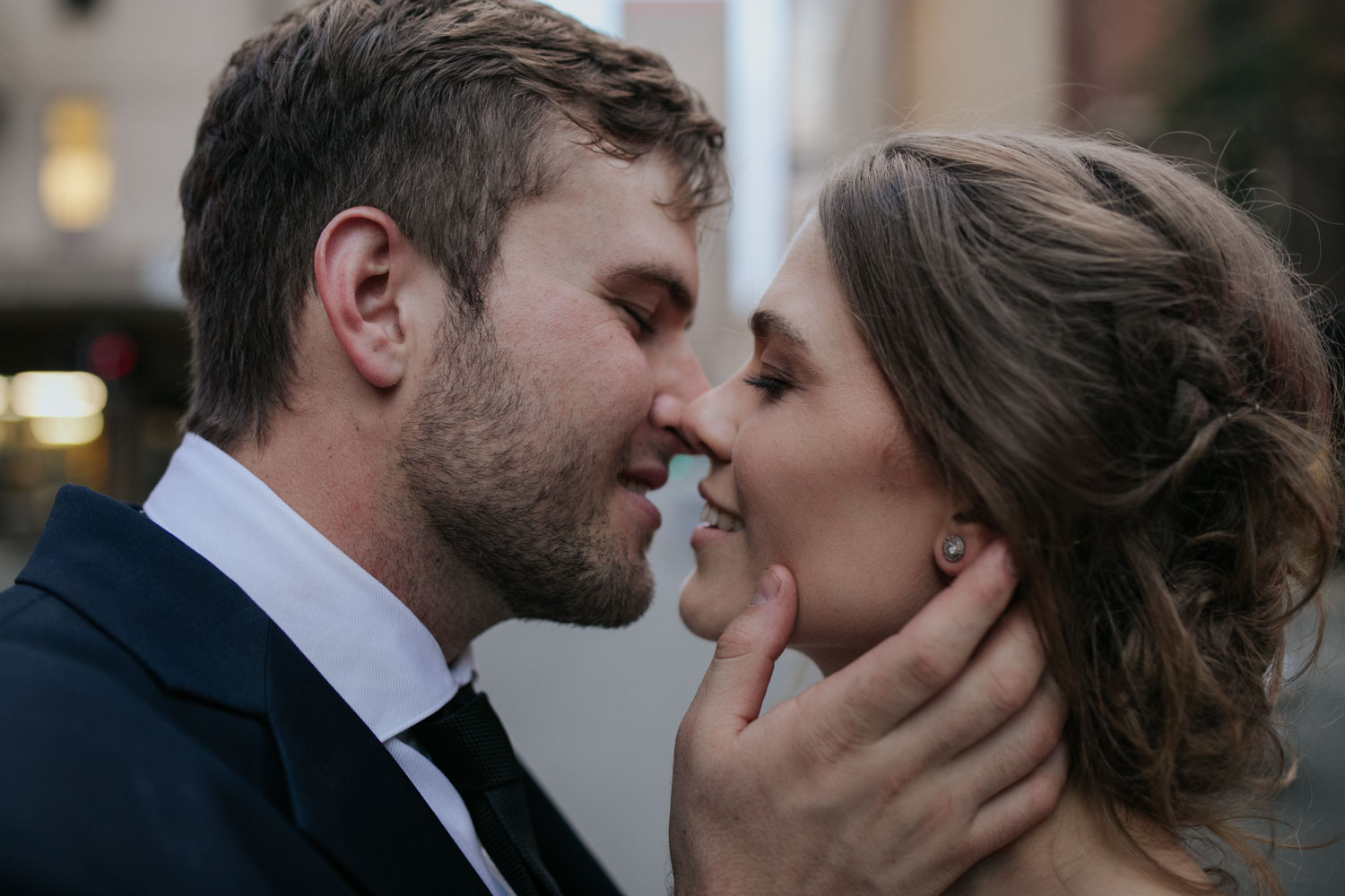 Before The First Kiss Grooms Holds Bride's Face
