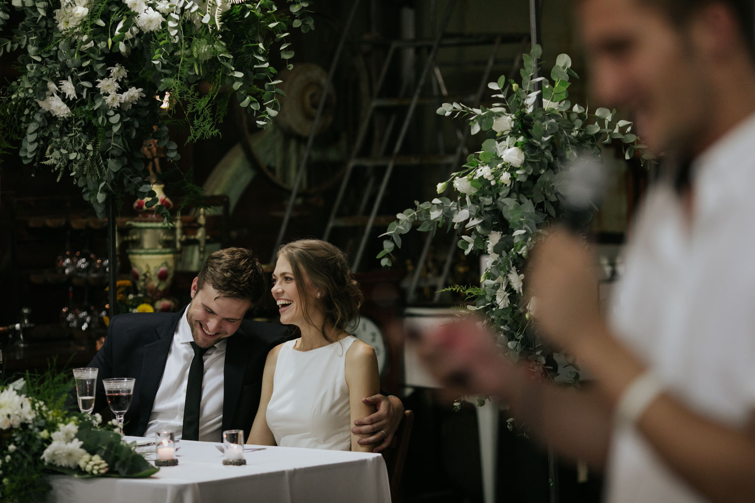 Natural Candid Moments Of Bride And Groom Laughing During Speeches at Vancouver Wedding