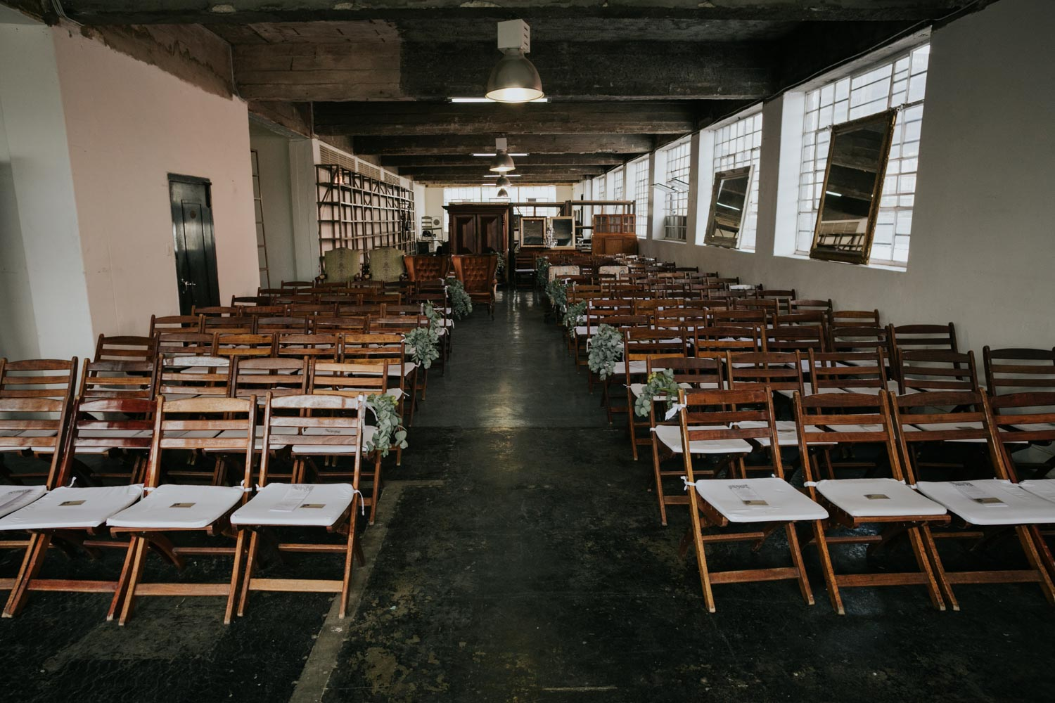 Wooden Wedding Chairs Set Out For Vancouver City Wedding In Old Warehouse