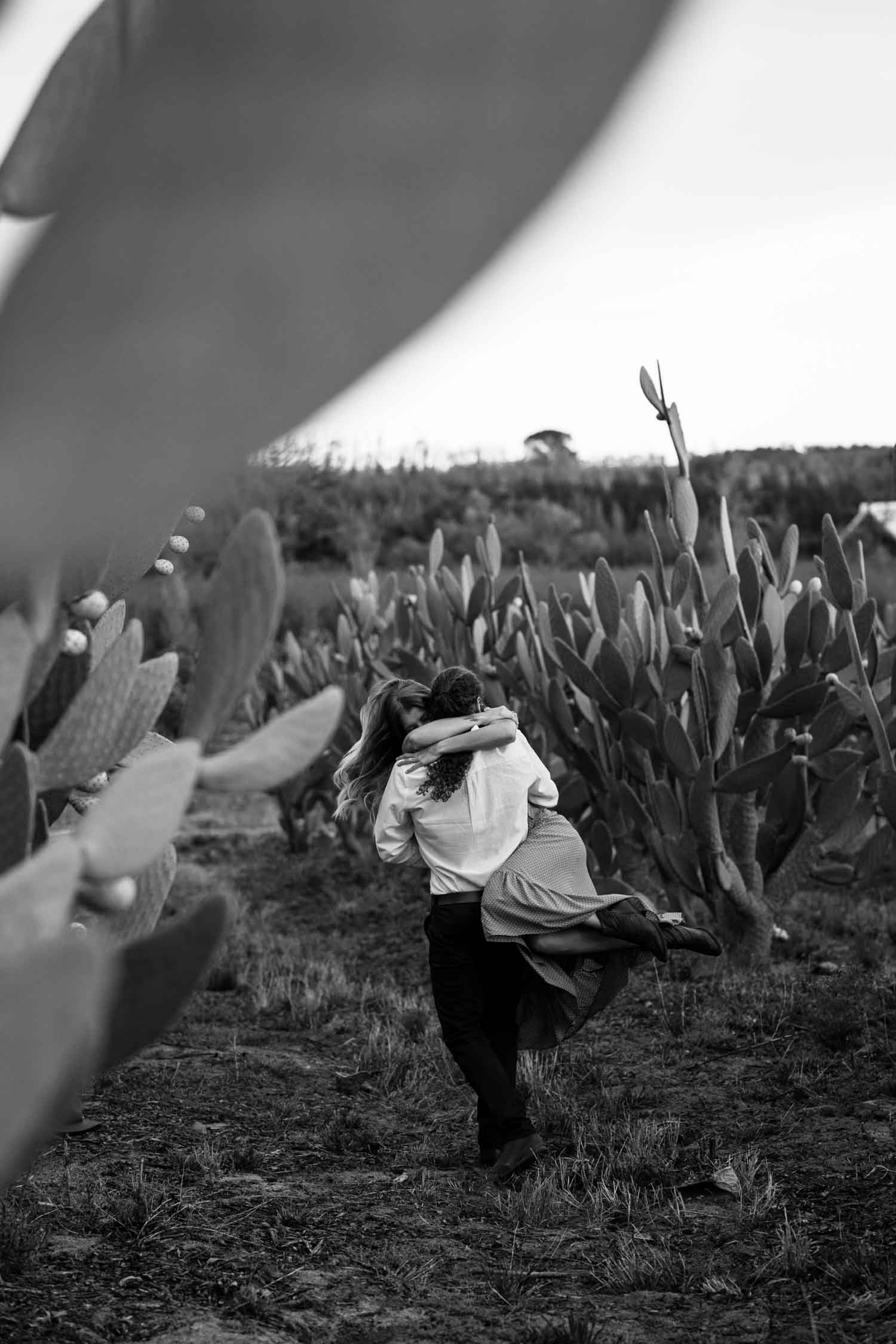 Boho Long Haired Couple Spin In A Cactus Field At Babylonstoren Cape Town