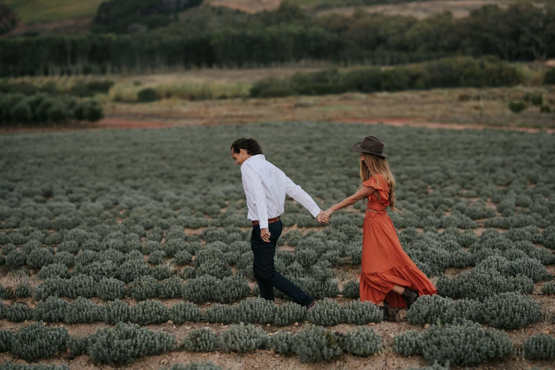 Boho Gypsy Couple Engagement Shoot Walk In Babylonstoren Farm Fields Below Mountains