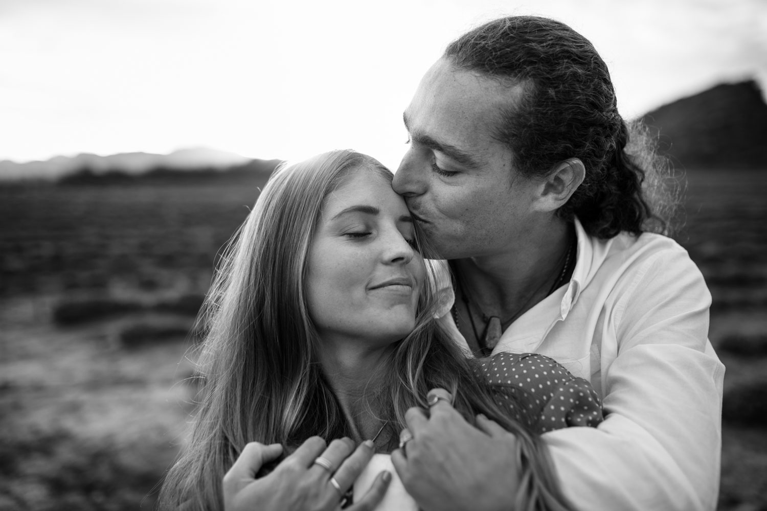 Boho Long Haired Couple Stand In Farm Field At Babylonstoren Cape Town
