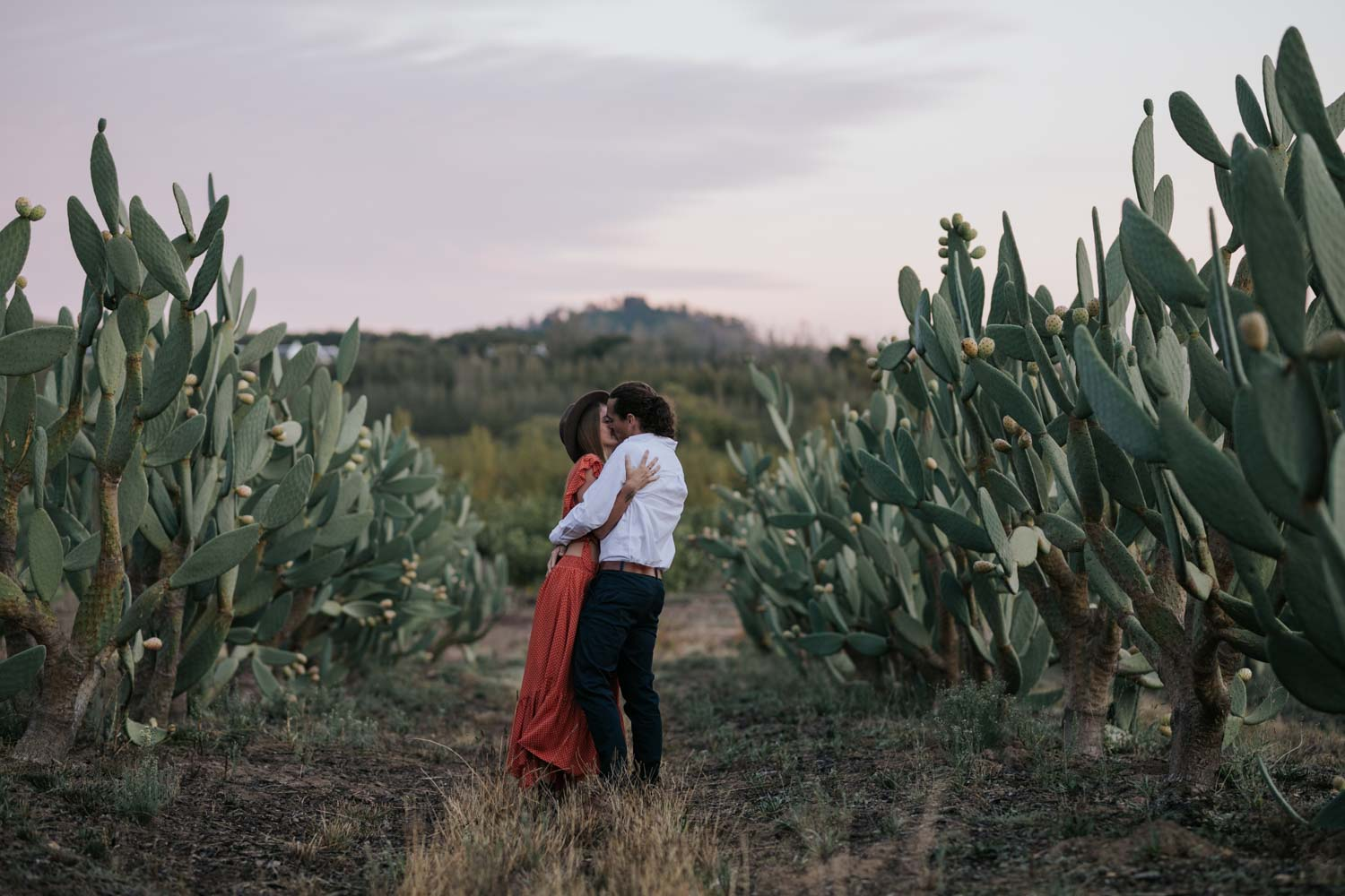 Boho Long Haired Couple Kiss In A Cactus Field At Babylonstoren Cape Town