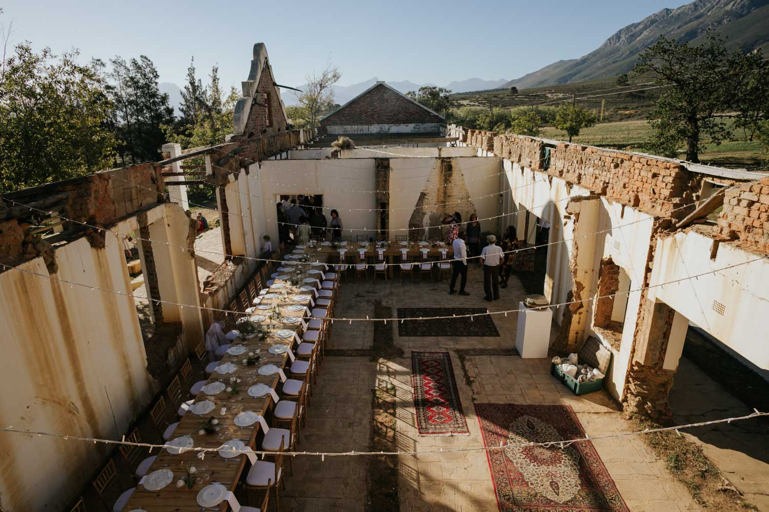 Wedding set in the ruins of an old Cape Dutch farmhouse in the mountains and wine lands close to Cape Town