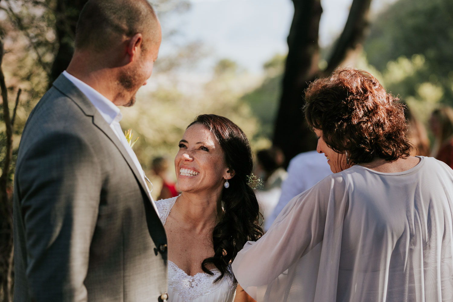 Bride's joyful and happy reaction towards her new husband after they have just got married