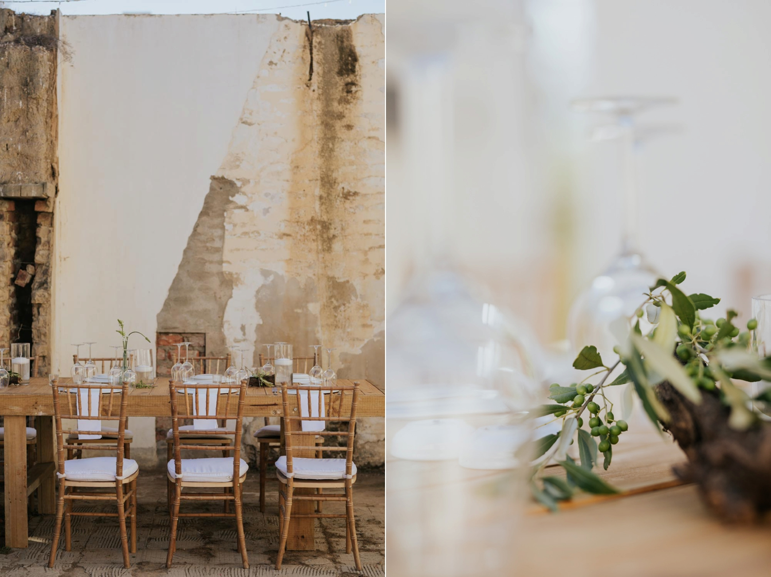 Simple wooden tables decorated with leaves, greenery and glass set in the ruins of an old house in the Western Cape.