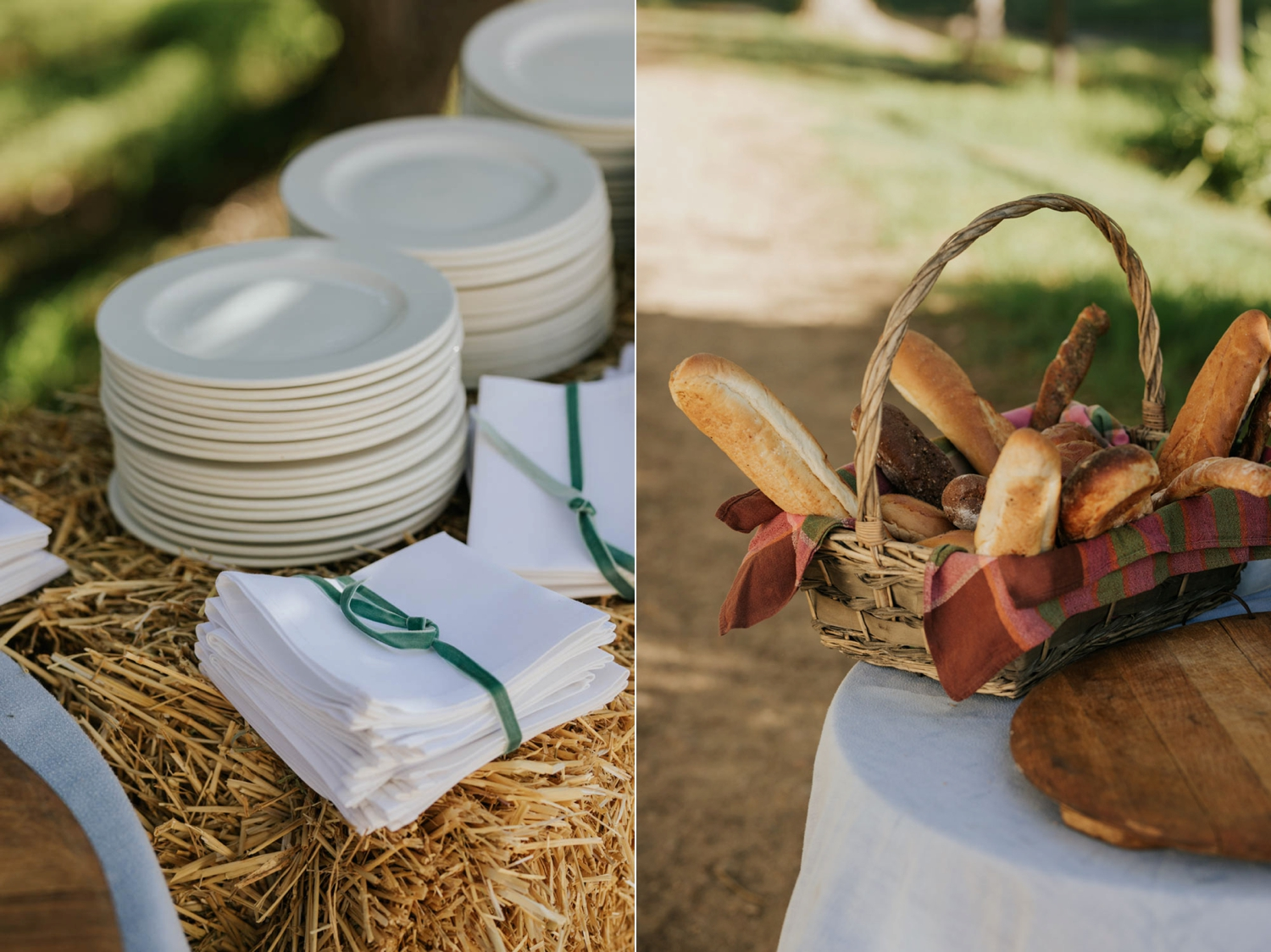A farm wedding harvest table made up of fresh bread, a cheese cake and fruit set under the trees on haybails in Tulbagh, Cape Town.