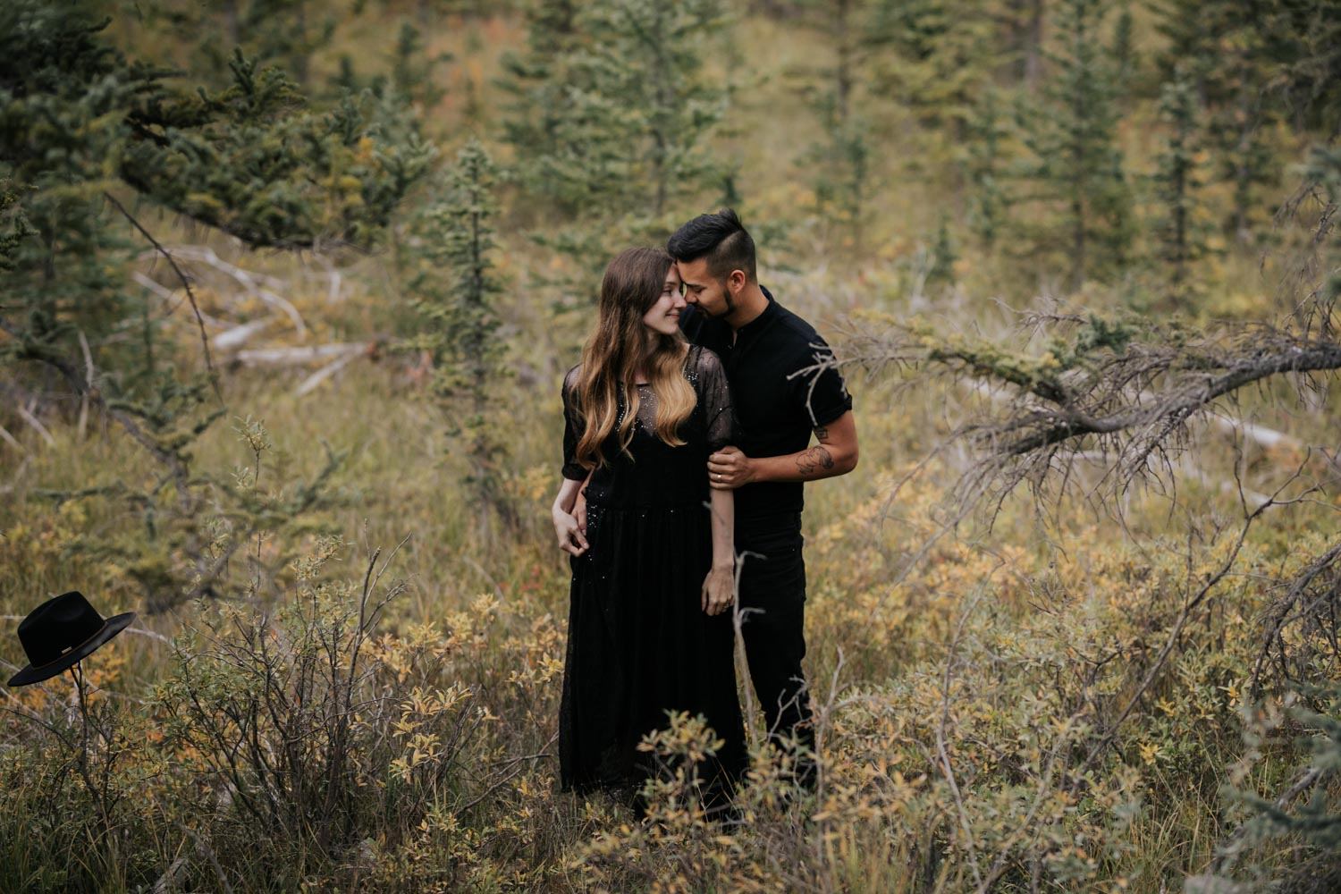 Incredible Photo Engaged Hipster Alternative Couple Standing in PNW Forest Looking Into Each other's Eyes