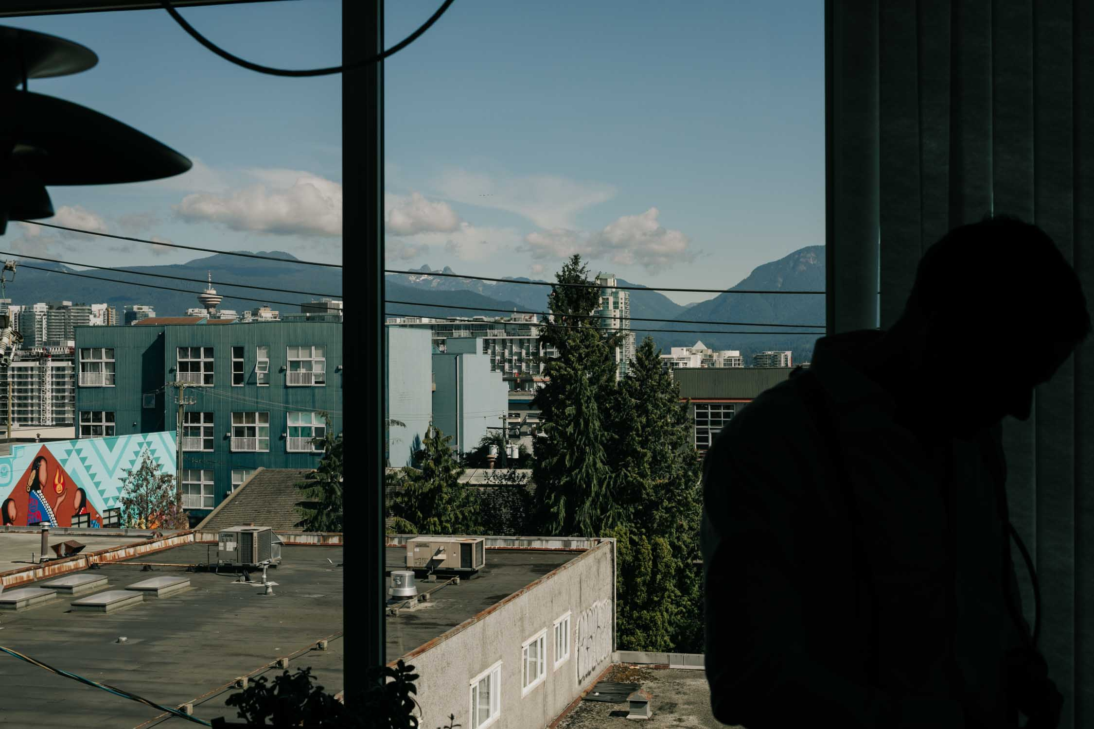 Mount Pleasant Apartment view of mountains, a great place for groom to get ready for his wedding in Vancouver