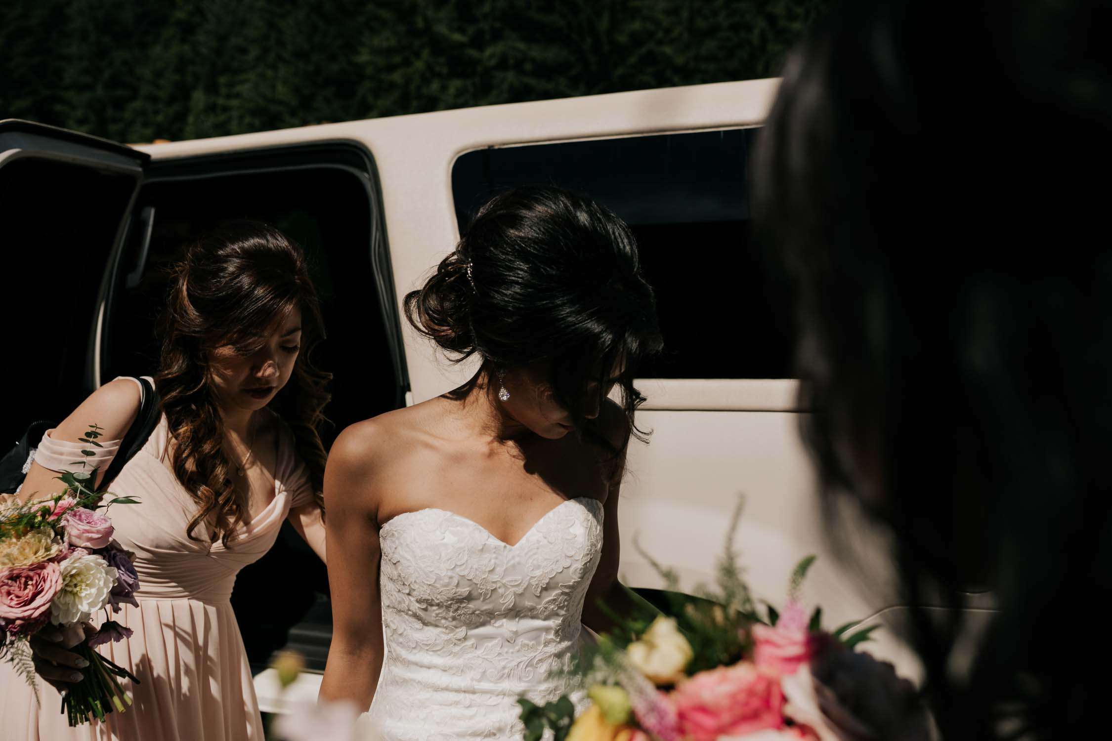 Bride Gets Out Of Car Grouse Mountain Wedding