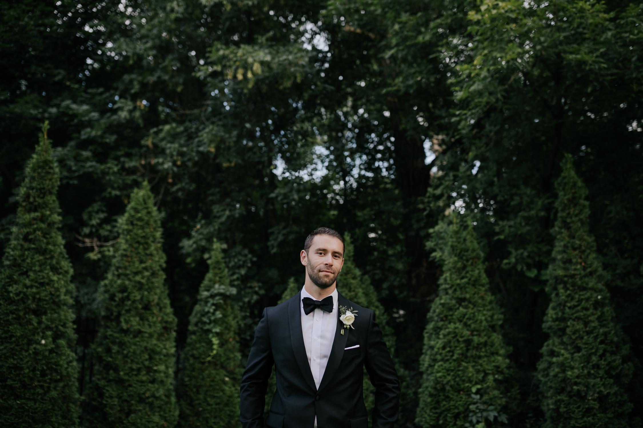 Groom portrait at Madsen's Greenhouse wedding venue in Newmarket close to Toronto