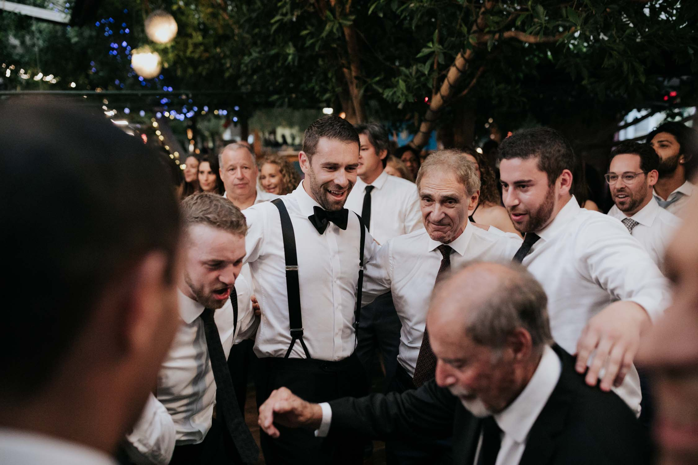 Horas and fun dancing photos at Groom portrait at Madsen's Greenhouse wedding venue in Newmarket close to Toronto