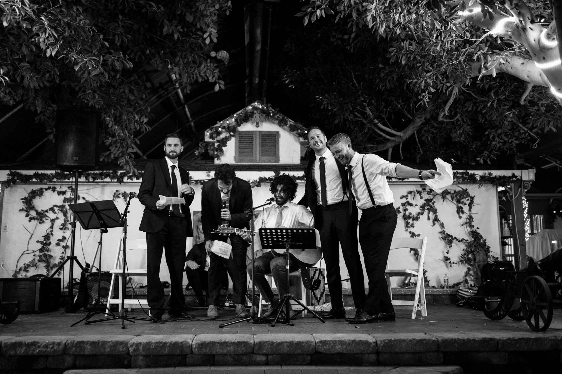 Best man and groomsmen sing their speech to the groom at Madsen's Greenhouse wedding venue in Newmarket close to Toronto
