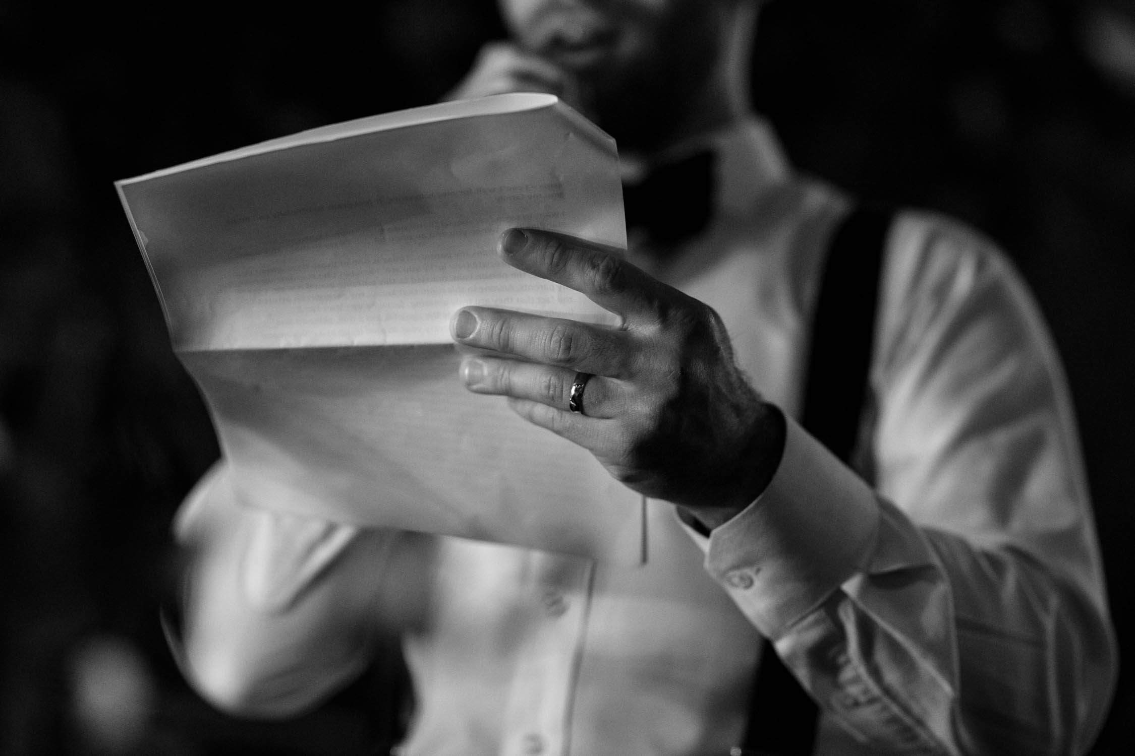 Photograph of groom with his new wedding ring on saying speech to his bride at Madsen's Greenhouse wedding venue in Newmarket close to Toronto