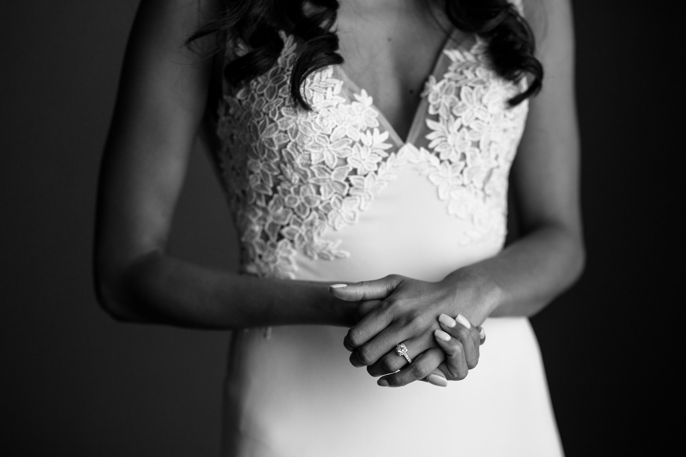 Bride's elegant and classic and trending wedding dress by Pearl Bridal Toronto with lace cut out at the back