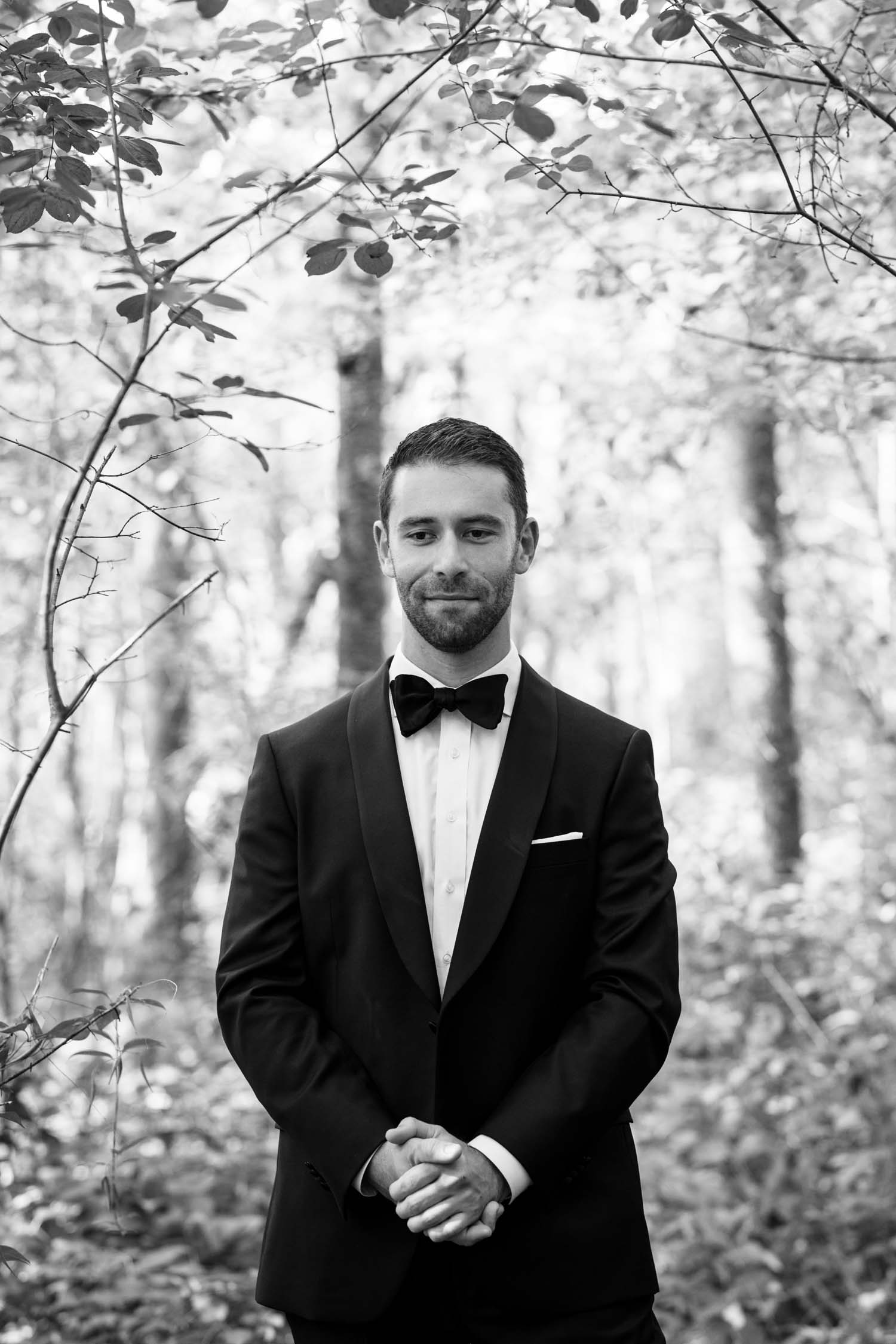 Groom waiting for his bride and their first look reveal in the forest at Fairy Lake Park in Newmarket