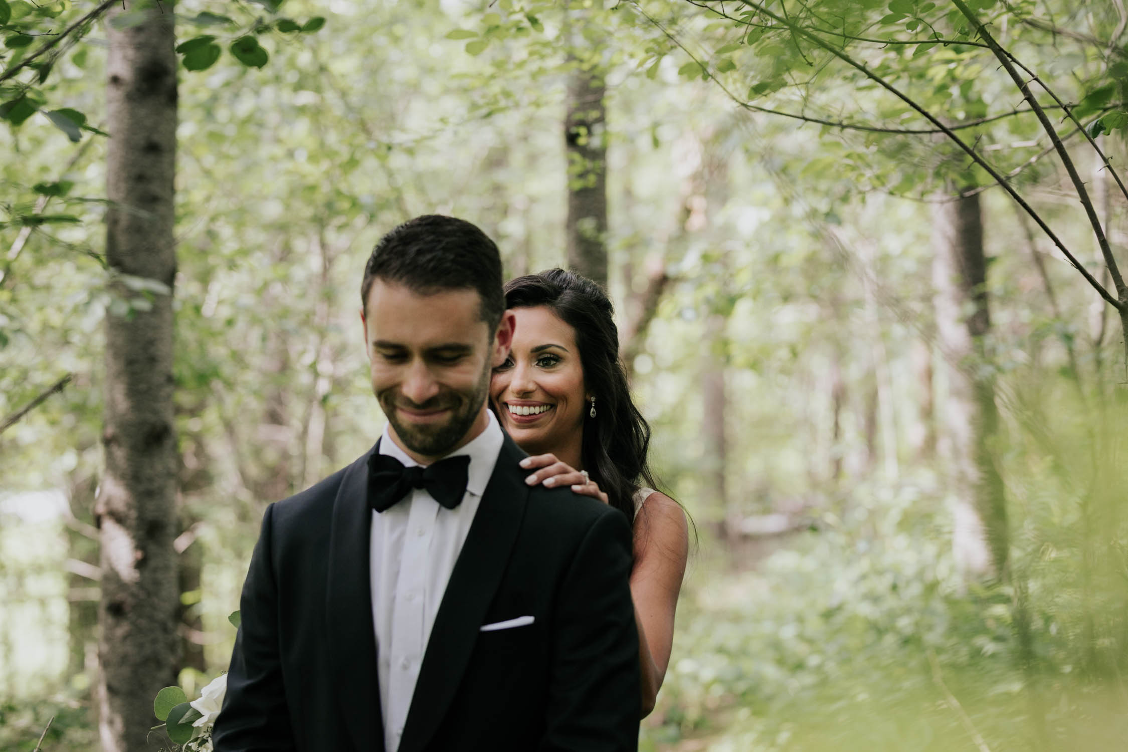Groom waiting for his bride and their first look reveal in the forest at Fairy Lake Park in Newmarket before their wedding at Madsen's Greenhouse