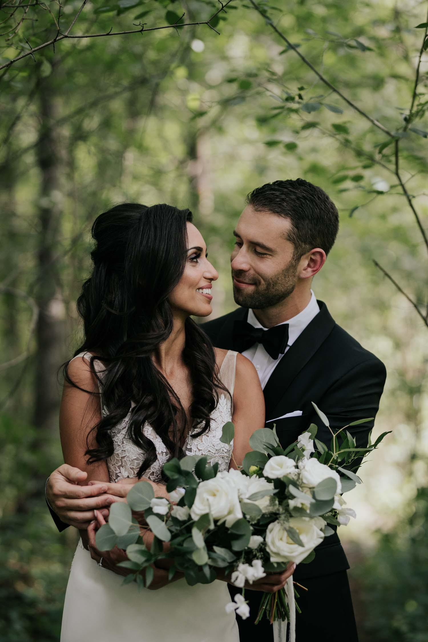 Emotional and natural candid photography at first look reveal in the forest at Fairy Lake Park in Newmarket before wedding at Madsen's Greenhouse