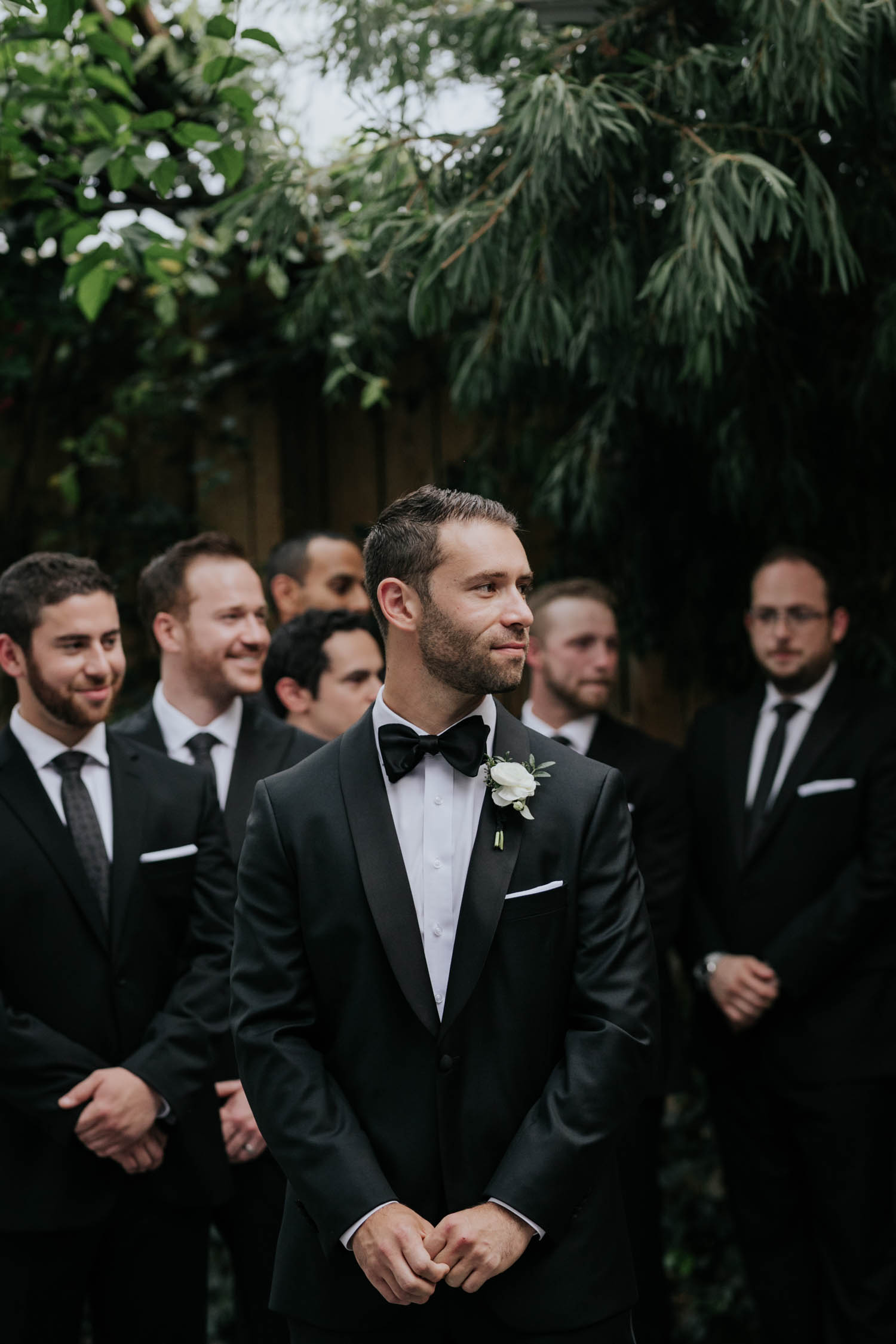 Groom watching his beautiful bride walk down aisle in Greenhouse chapel at Madsen's Greenhouse wedding venue in Newmarket close to Toronto