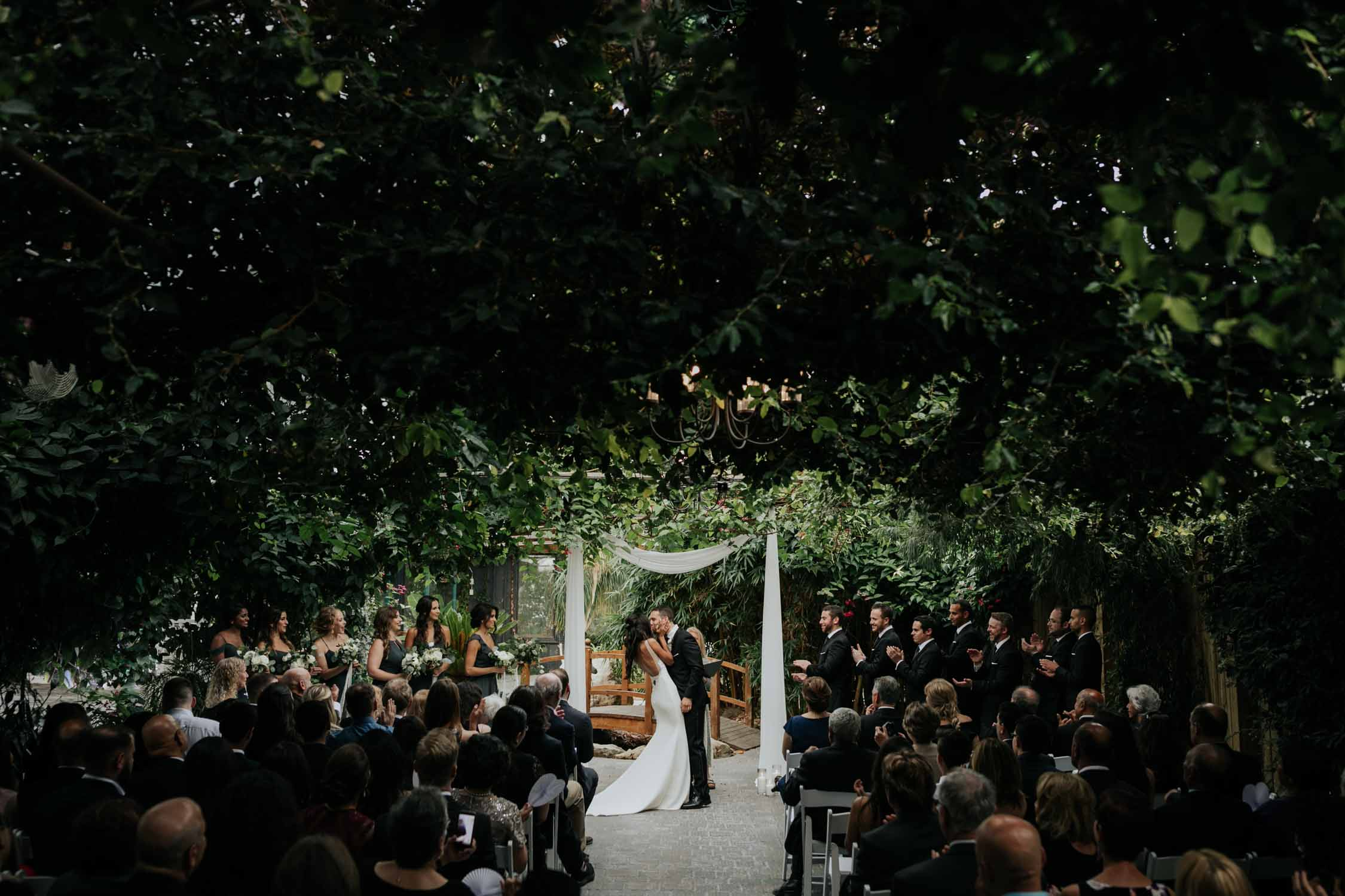 First kiss at Madsen's Greenhouse wedding venue in Newmarket close to Toronto