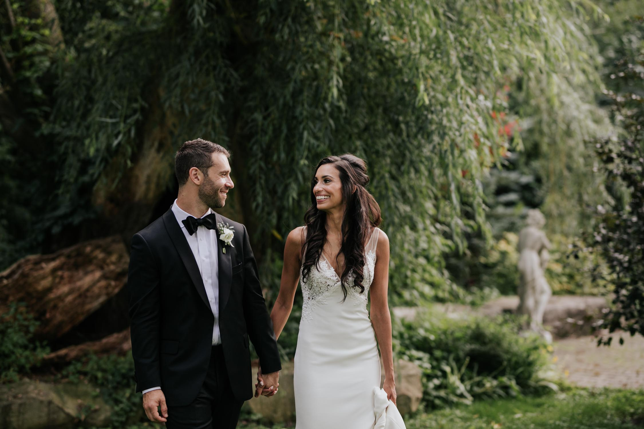 Happy and natural Vancouver wedding photographer at Madsen's Greenhouse wedding venue in Newmarket close to Toronto