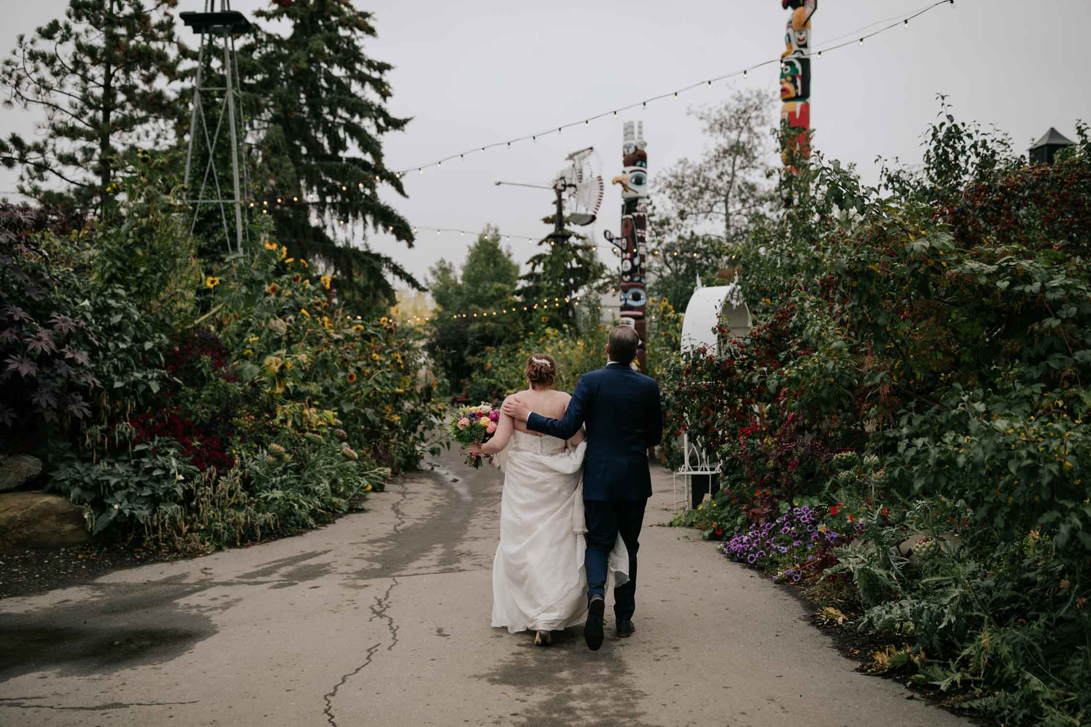 Bride and groom walk into wedding reception at Saskatoon Farm Wedding Venue in Calgary, Alberta.