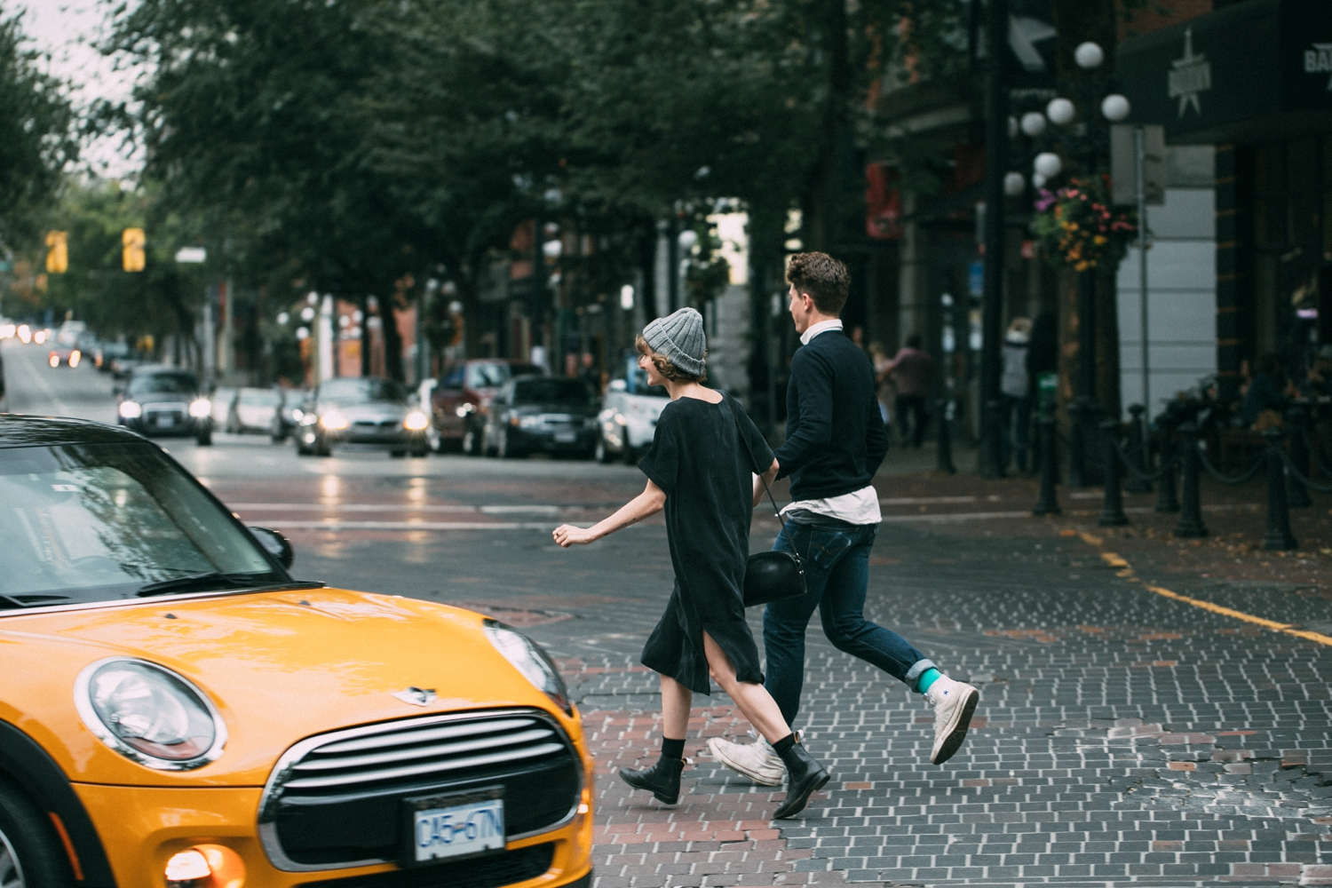 Trendy Hipster Couple Running across Road in Gas Town, VanCity