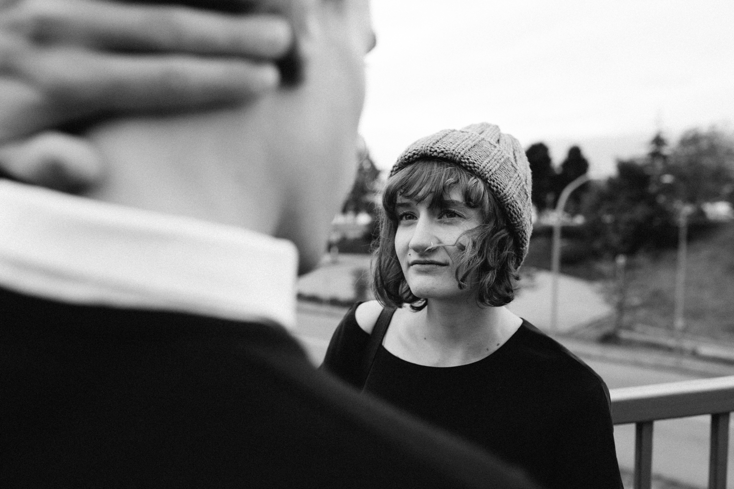 Hipster Girl Looks At Boy Wearing Toque