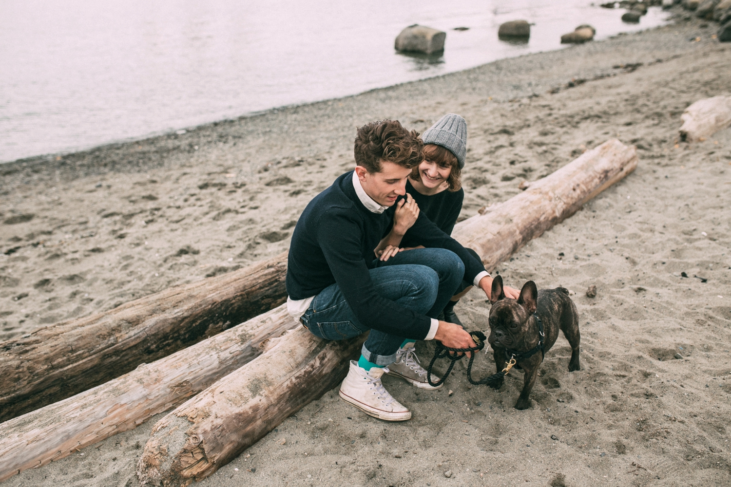 Couple And Boston Terrier Dog On Beach Vancouver British Columbia
